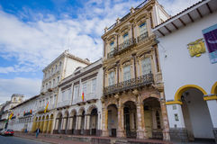 Cuenca, Ecuador - April 22, 2015: Beautiful spanish colonial townhouses with decorated facades, traditional Cuenca architecture an Royalty Free Stock Image