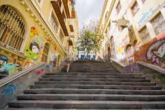 Cuenca, Ecuador - April 22, 2015: Charming concrete staircase with urban art and graffiti connecting city streets.  Royalty Free Stock Photo