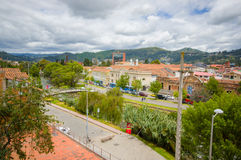 Cuenca, Ecuador - April 22, 2015: Nice overview part of city with rooftops visible amongst green trees Royalty Free Stock Image