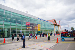 Cuenca, Ecuador - April 22, 2015: Passengers entering airport terminal building from runway area, red cones and markings on surfac Royalty Free Stock Image