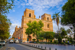 Cuenca, Ecuador - April 22, 2015: Spectacular main cathedral located in the heart of city, beautiful brick architecture and facade Stock Photo
