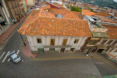 Cuenca, Ecuador - April 22, 2015: Typical townhouse with distinct red shingle rooftop as seen from high above, mild Royalty Free Stock Photo