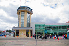 Cuenca, Ecuador - April 22, 2015: Yellow airport control tower standing next to terminal building Royalty Free Stock Photo