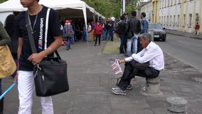 Cuenca, Ecuador - 20181003 - Cuenca Independence Day Festival - Wide Shot of Lottery Ticket Vendor Shouting His War stock footage