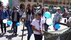 Cuenca, Ecuador - December 1, 2018 - Boy and Girl Scouts March Together in Celebration. Cuenca, Ecuador - December 1, 2018 - Boy and Girl Scouts March Together stock footage