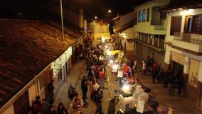 Cuenca, Ecuador - December 31, 2018 - Drone flies along street showing installation art on New Years Eve. Cuenca, Ecuador - December 31, 2018 - Drone flies along stock video footage