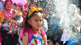 Little girls dancers dressed in colorful costume at the parade. royalty free stock image