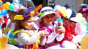 Little girls dressed in carnival costumes with cans of spray stock images