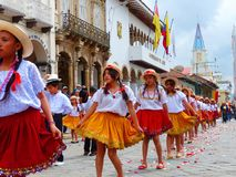 Cuenca, Ecuador. Group of girls dancers dressed in colorful costumes as cuencanas at the parade royalty free stock image