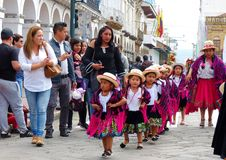 Cuenca, Ecuador. Group of girls dancers dressed in colorful costumes as cuencanas at the parade royalty free stock images