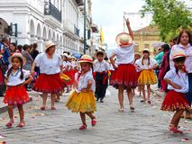 Cuenca, Ecuador. Group of kids dancers dressed in colorful costumes as cuencanas at the parade stock images