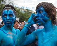 Cuenca, Ecuador / Jan 6, 2013: Two teenagers dressed as Avatars. With one on phone stock image