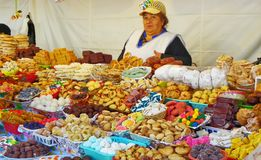 Woman trader sells traditional sweets during catholic Corpus Christi celebration in at open market in Cuenca stock photos
