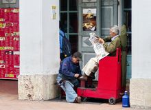 Man cleaning shoes at the street, Ecuador royalty free stock photos