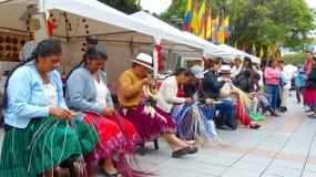 Women demonstrate weaving of Panama Hat, Ecuador stock images