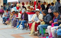 Traditional weaving of ecuadorian Panama Hat or Straw Hats, Ecuador. Cuenca, Ecuador - March 8, 2019: Women in traditional dresses of Azuay province demonstrate stock photography