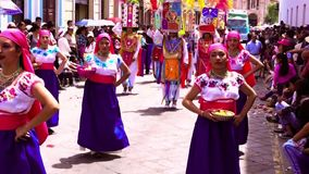 Cuenca, Ecuador / November 3, 2016 - Women in blue skirts dance in Cuenca Independence Parade stock video footage