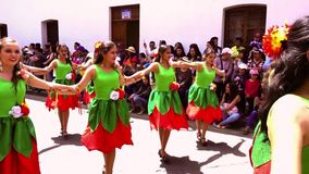 Cuenca, Ecuador / November 3, 2016 - Women in green and red dresses dance in Cuenca Independence Parade stock footage