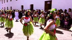 Cuenca, Ecuador / November 3, 2016 - Women in green skirts dance in Cuenca Independence Parade stock footage