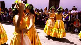 Cuenca, Ecuador / November 3, 2016 - Women in yellow dresses dance in Cuenca Independence Parade stock footage