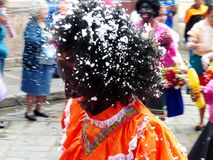 Cuenca, Ecuador. Parade during Carnival. Women dancers wearing masks and colorful dresses. royalty free stock photography