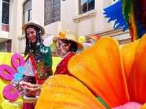 Cuenca, Ecuador. Parade during Carnival. Young woman and man dressed in ecuadorian national costume covered with foam royalty free stock images
