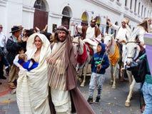 Cuenca, Ecuador. Parade Pase del Niño Viajero, Joseph and Mary with baby Jesus doll stock photo