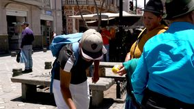 Cuenca, Ecuador - 20180920 - Street Vendor Tries To Sell Chontacuro To Indigenous Woman2. stock video footage