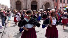 Cuenca, Ecuador - 20160206 - Women Dance in Parade in Traditional Dresses as Audience Sprays Them With Foam. Cuenca, Ecuador - 20160206 - Women Dance in Parade stock footage