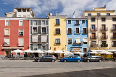 Cuenca 4. CUENCA, SPAIN - APRIL 15, 2013: Restaurant terraces facing the colorful houses of the square of Cuenca, Spain Stock Photo