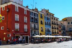 Cuenca, Spain - Sep 29 2018 View of Plaza Major with colour houses and people sitting in the sun royalty free stock images