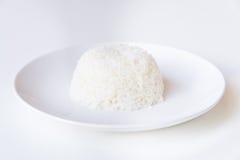 Cuenco de arroz en el fondo blanco Foto de archivo