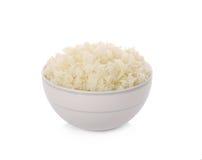 Cuenco de arroz en el fondo blanco Fotos de archivo libres de regalías