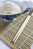 Cuenco de arroz y palillos Imagen de archivo libre de regalías