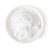 Cuenco de azúcar de polvo en el fondo blanco, visión superior imagen de archivo libre de regalías
