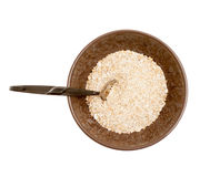 Cuenco de cereal con una cuchara fotos de archivo