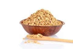 Cuenco de granola con la cuchara de madera Fotografía de archivo libre de regalías