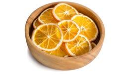 Cuenco de madera con la naranja seca Imagen de archivo libre de regalías