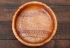 Cuenco de madera vacío en el vector de madera Imagen de archivo