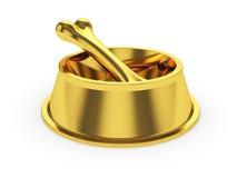 Cuenco de oro de los animales domésticos con el hueso del oro Fotos de archivo
