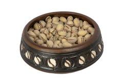 Cuenco de pistachos Foto de archivo libre de regalías
