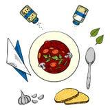 Cuenco de sopa caliente con pan y condimentos Imagen de archivo