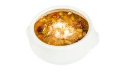 Cuenco de sopa del minestrone con el queso parmesano Aislado Foto de archivo libre de regalías