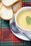 Cuenco de sopa y de pan Foto de archivo libre de regalías