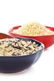 Cuencos de arroz crudo Foto de archivo libre de regalías