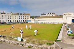 Cuencos de las señoras en un bowling green Teignmouth Devon Foto de archivo