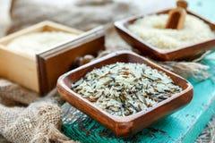 Cuencos de madera con arroz Fotografía de archivo