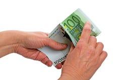 Cuenta de 100 billetes de banco euro Fotografía de archivo libre de regalías