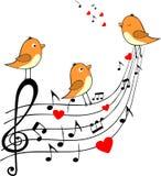 Cuenta del amor con tres pájaros anaranjados Foto de archivo libre de regalías