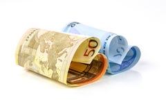 Cuenta del euro dos bajo la forma de corazón Fotografía de archivo libre de regalías